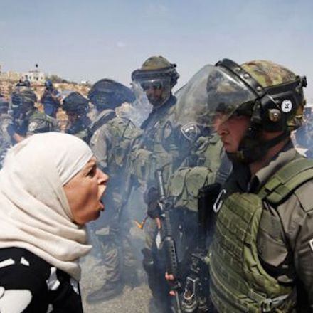 palestinian woman argues with israeli border policeman west bank
