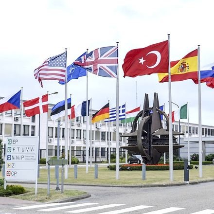 Member flags fly outside NATO Headquarters in Brussels ahead of today's extraordinary meeting to discuss Islamist terrorist attacks and Turkish security. Source: Getty