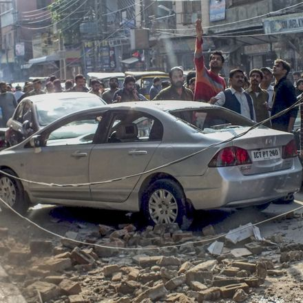 Debris of buildings and panicked Pakistani residents are seen in the streets following a massive earthquake in Rawalpindi, Pakistan. Source: Getty