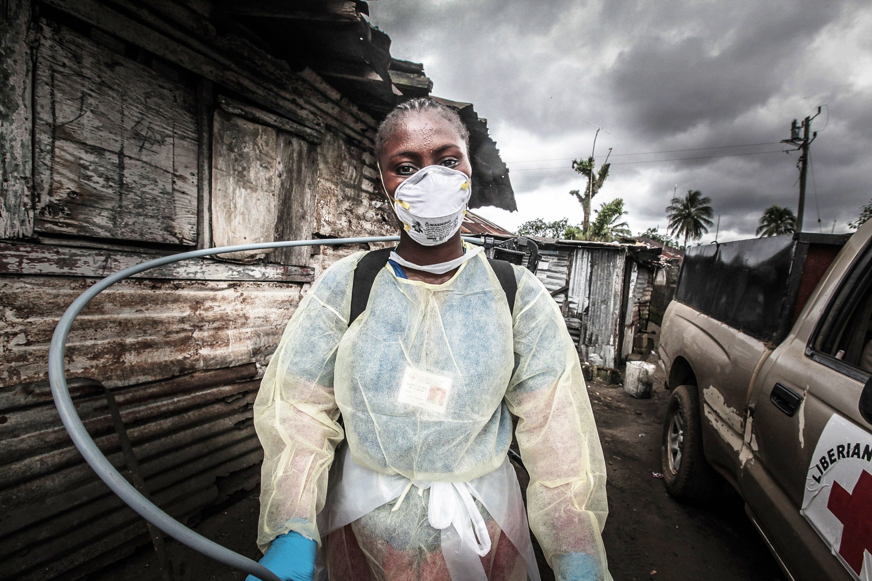 an African woman wears a mask to cover her face from the ebola virus