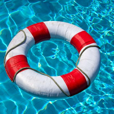 Life buoy in swimming pool shutterstock 112595561