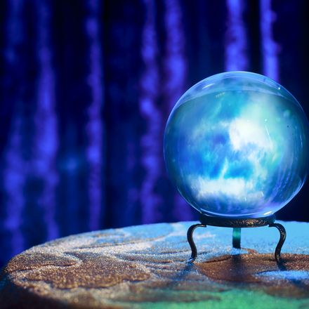 Magic crystal ball on table shutterstock 132890300