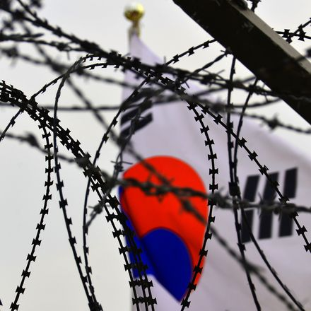South Korea flag razor wire demilitarized zone North Korea shutterstock 135694022