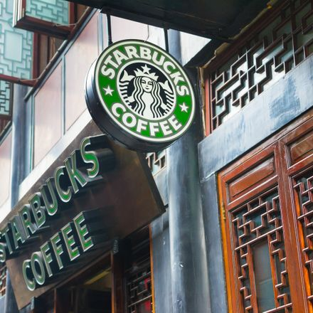 a sign for the Starbucks coffee store chain