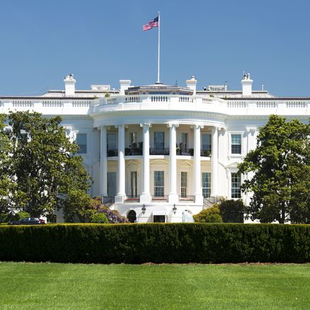 White House on deep blue sky background shutterstock 147037244