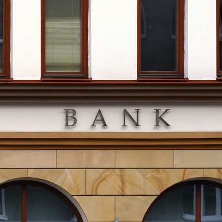 Small bank building facade shutterstock 169866395