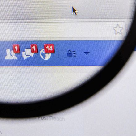 Facebook news feed magnifying glass shutterstock 214779115