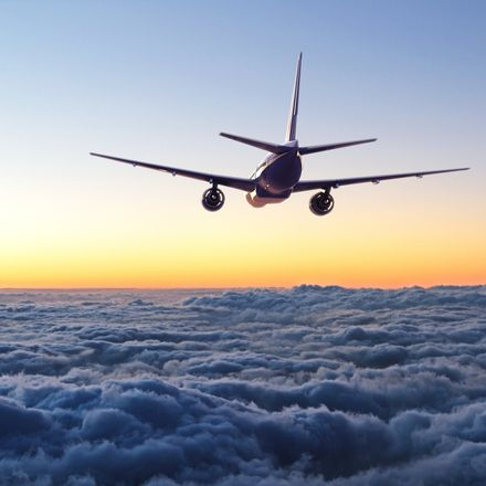 Airplane flying away over clouds shutterstock 311421530