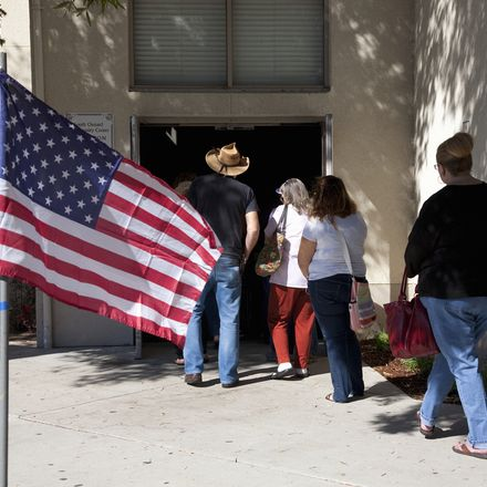 Voters in line American flag shutterstock 314605481
