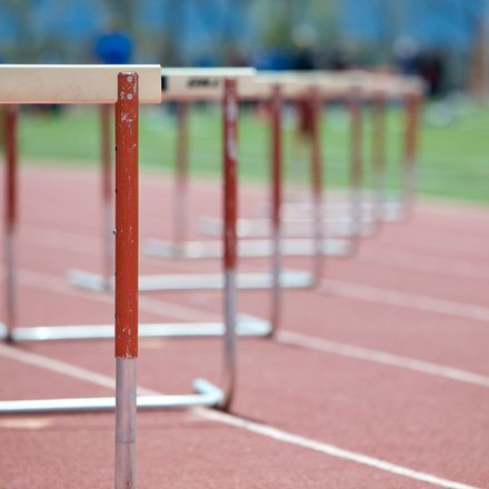 Hurdles lined up on track shutterstock 33174835