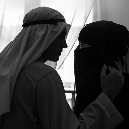 Arabian couple veil intimate bedroom shutterstock 405975433