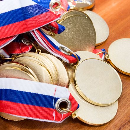 Pile of gold medals olympics shutterstock 4516078