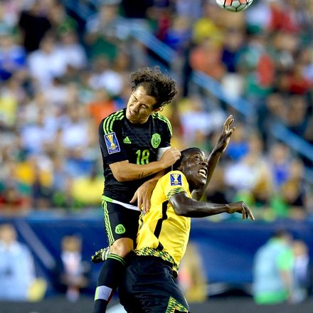 Mexico's Andres Guardado, left, goes high for a header against Jamaica's Je-Vaughn Watson during the 2015 CONCACAF Gold Cup final.
