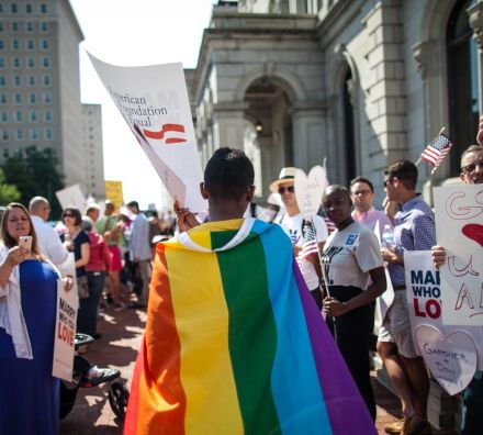 A gay marriage supporter wears a rainbow cape at Virginia's 4th U.S. Circuit Court of Appeals.
