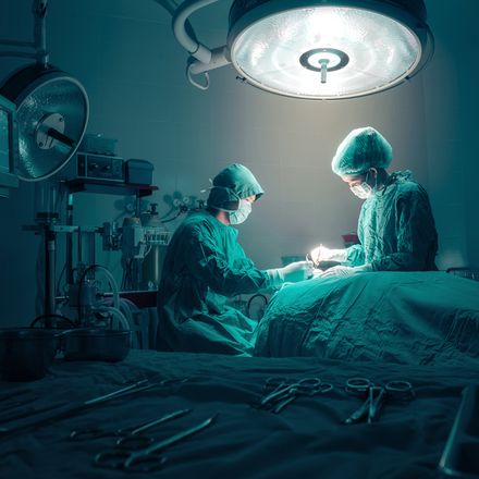 Surgeons in operating room shutterstock 297132446