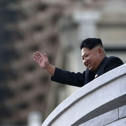 North Korea's leader Kim Jong-Un waves from a balcony towards participants of a mass military parade in October. Source: Getty