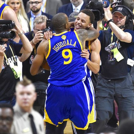 Golden State Warriors Stephen Curry and MVP Andre Iguodala celebrate after beating the  Cleveland Cavaliers in Game 6 to win the 2015 NBA Finals.