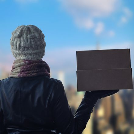 woman with delivery box in winter shutterstock 1188869926