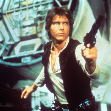 Han Solo facing right of camera slighly pointing his weapon