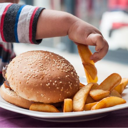 child eating fast food shutterstock 1111941848